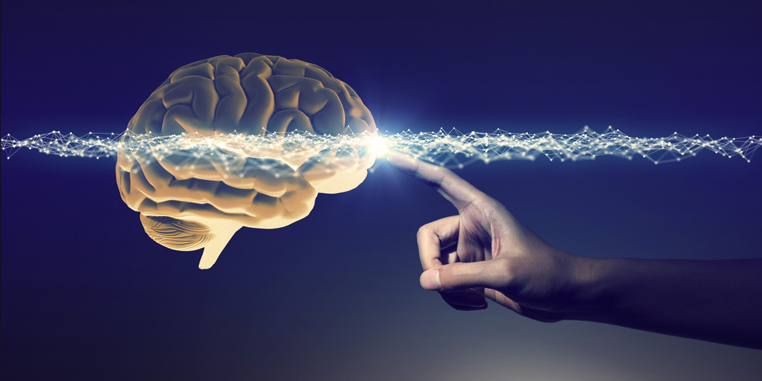 photo illustration suggestive of a human finger activating brain activity
