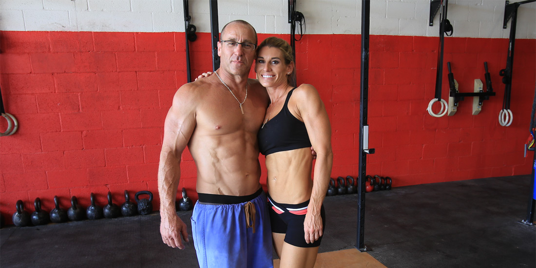 Dr. Osborn, shirtless and muscular with his female assistant, also muscular and fit