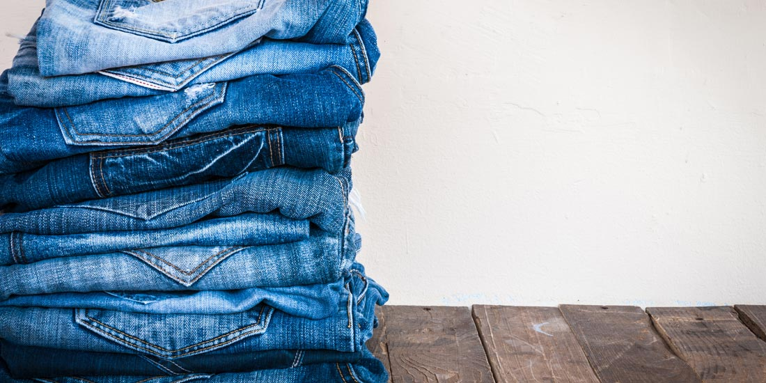 Neatly stack of folded jeans after being washed
