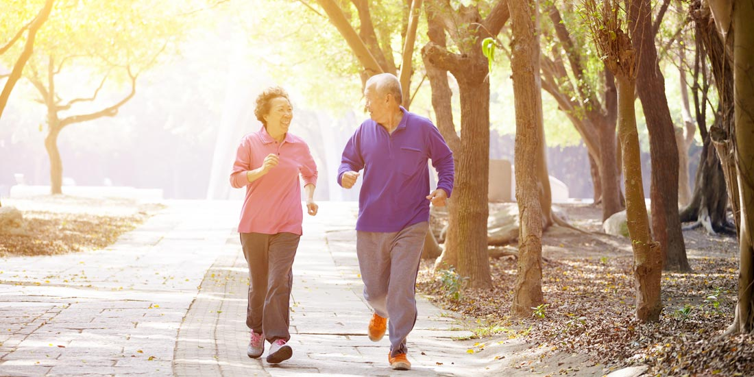 eldery couple running to help stop Alzheimer's disease
