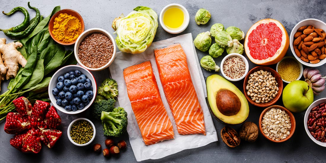 image of healthy food surrounded by servings of ready to cook Salmon